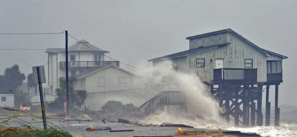 Waves crash on to stilt houses along the shore at Alligator Point in Franklin County, Florida. Photograph: Steve Nesius/Reuters